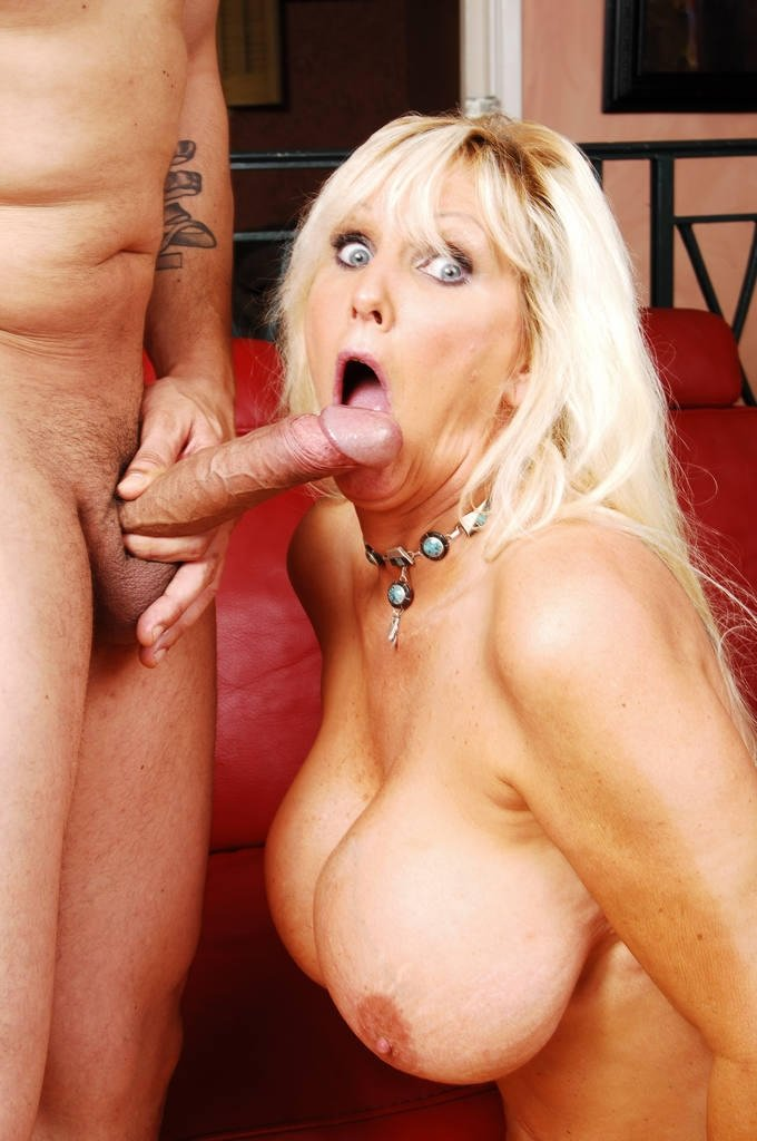 huge tits blonde babe receives a tasty black cock