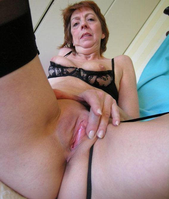 Wife masterbating on rubberball with dildo