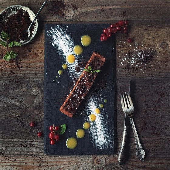 Ресторан The Five Points - фотография 22 - Шоколадный мусс с апельсиново-розмариновым соусом