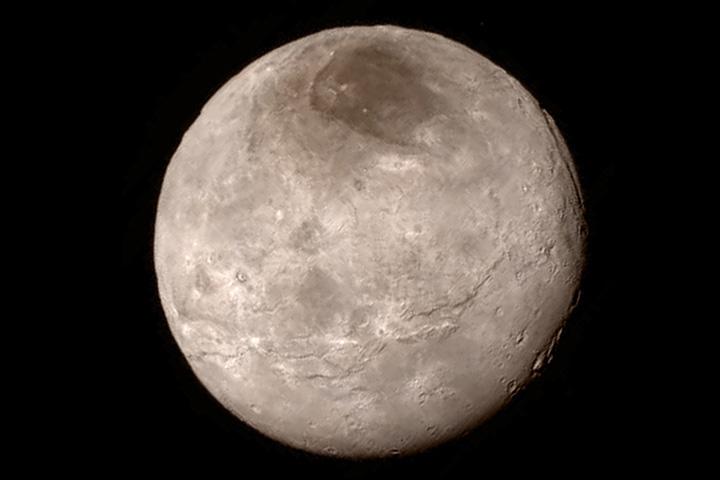 Фотография Харона, крупнешего спутника Плутона