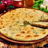 Ресторан Осетинские пироги №1 - фотография 2 - Осетинский пирог со свекольными листьями.