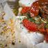 Ресторан Boston Seafood & Bar - фотография 6 - Треска, запеченная в пергаменте с овощами
